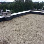 Montaż EPDM w systemie balastowym na dachu